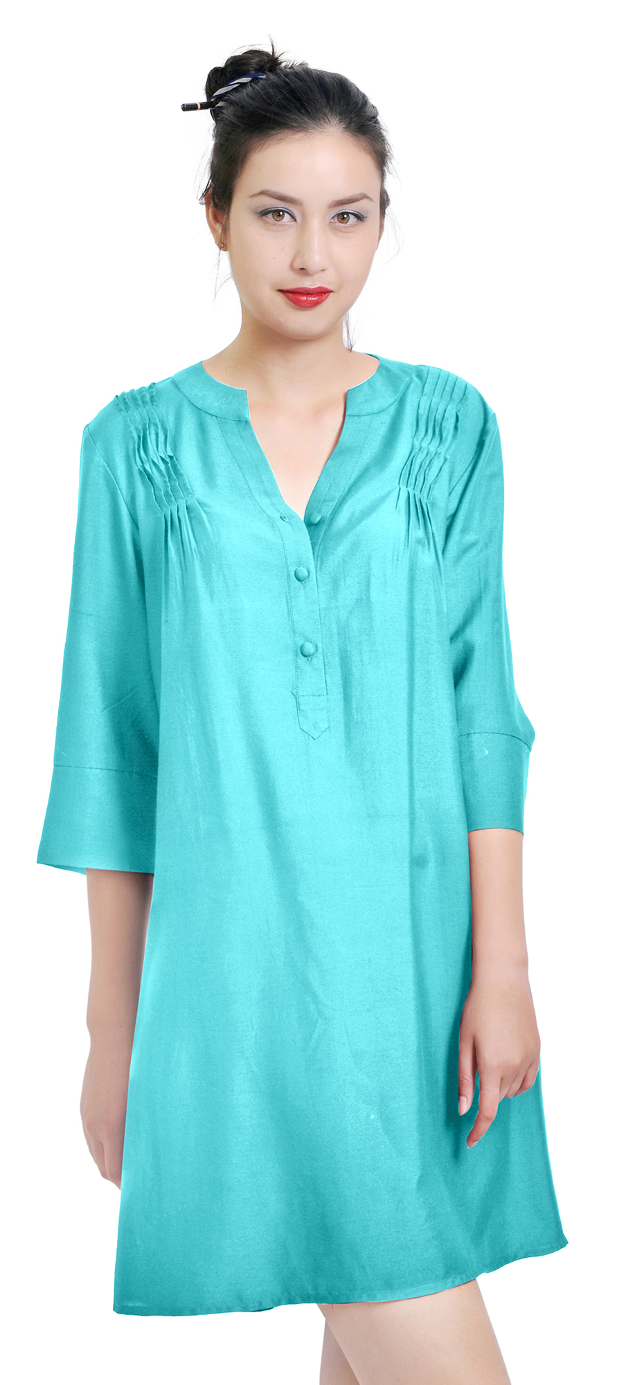 Made of the softest silk blend, the designs on this sleek tunic top are inspired by traditional sari fabric. Each tunic is beautifully enhanced on the front and back with traditional embroidery that is hand-done by women artisans in Northern India.